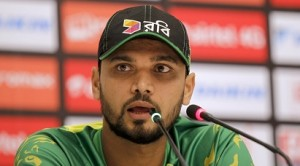 Bangladesh's cricket team captain Mashrafe Mortaza addresses a press conference ahead of the Asia Cup tournament in Dhaka, Bangladesh, Tuesday, Feb. 23, 2016. Bangladesh will play with India in the opening match of the five nations Twenty20 cricket event that begins Wednesday. (AP Photo/A.M. Ahad)